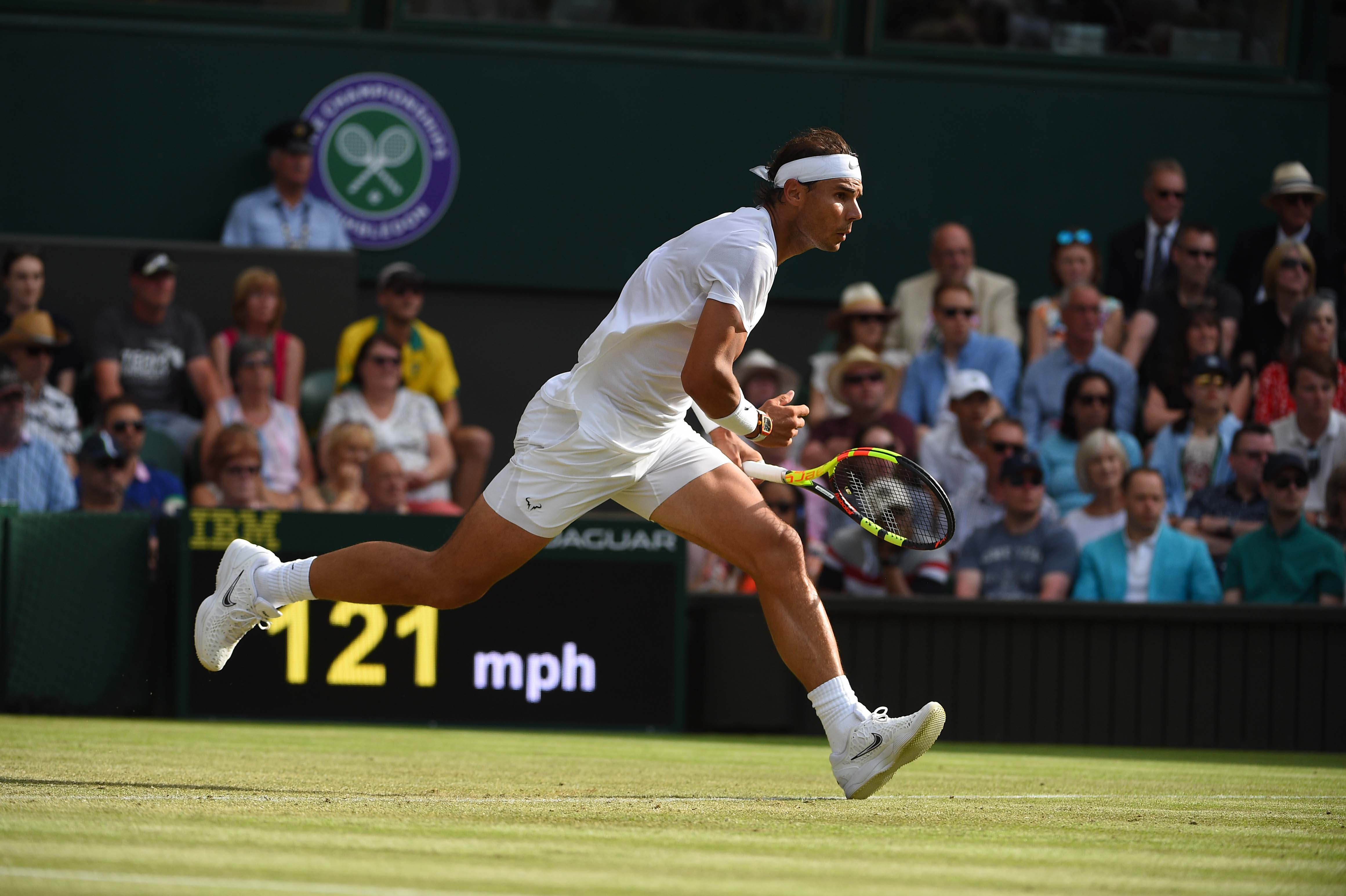 Rafael Nadal running for a shot against Nick Kyrgios at Wimbledon 2019