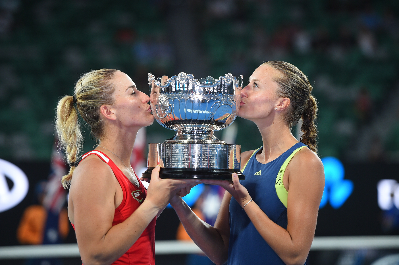 Timea Babos and Kristina Mladenovic kiss the 2018 Australian Open women's double trophy