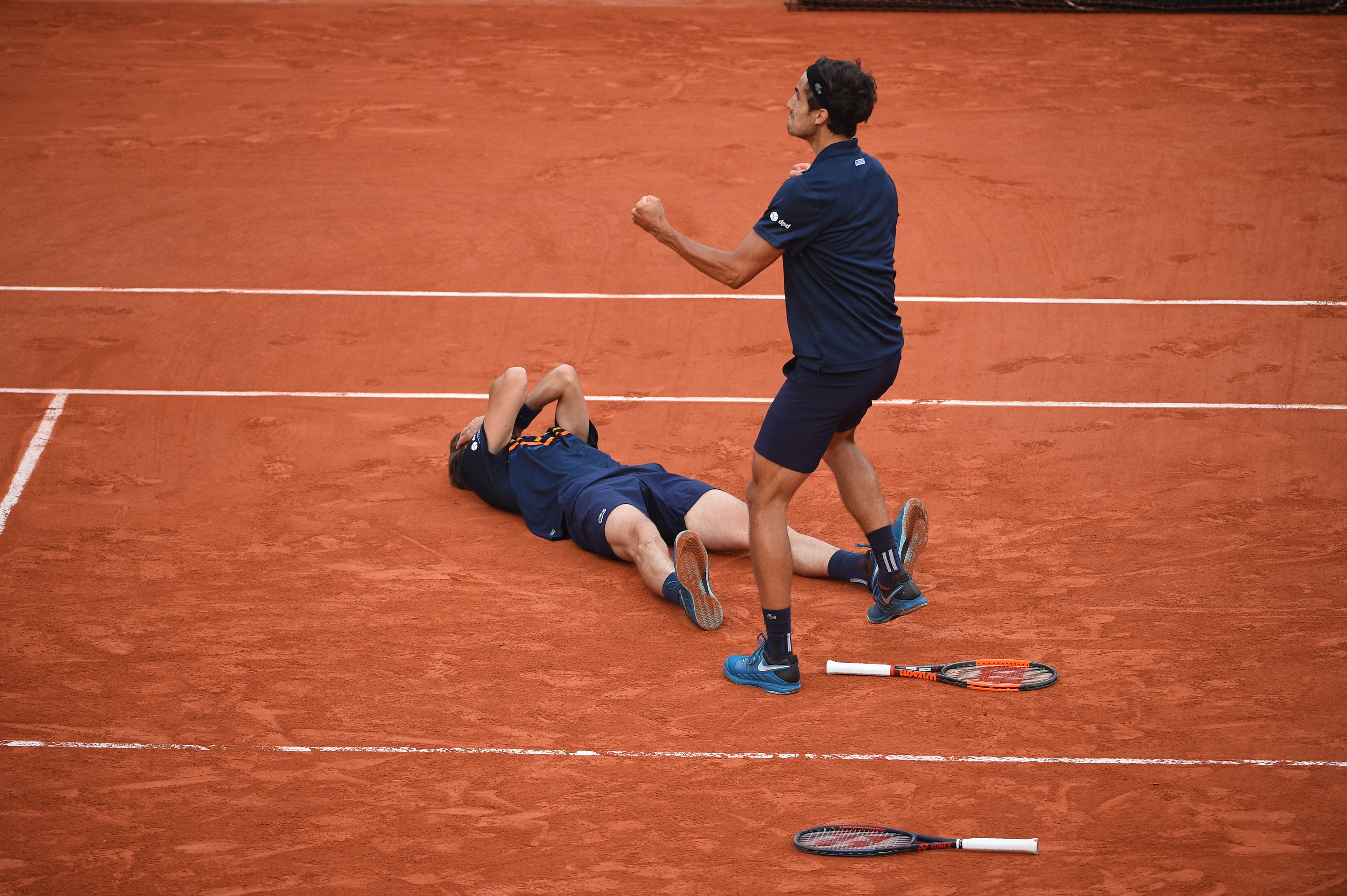 Nicolas Mahut and Pierre-Hugues Herbert happy with the win at Roland-Garros 2018