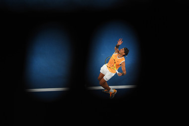 Rafael Nadal serving in the shadow during his third round match against Alex de Mianur at the Australian Open 2019.