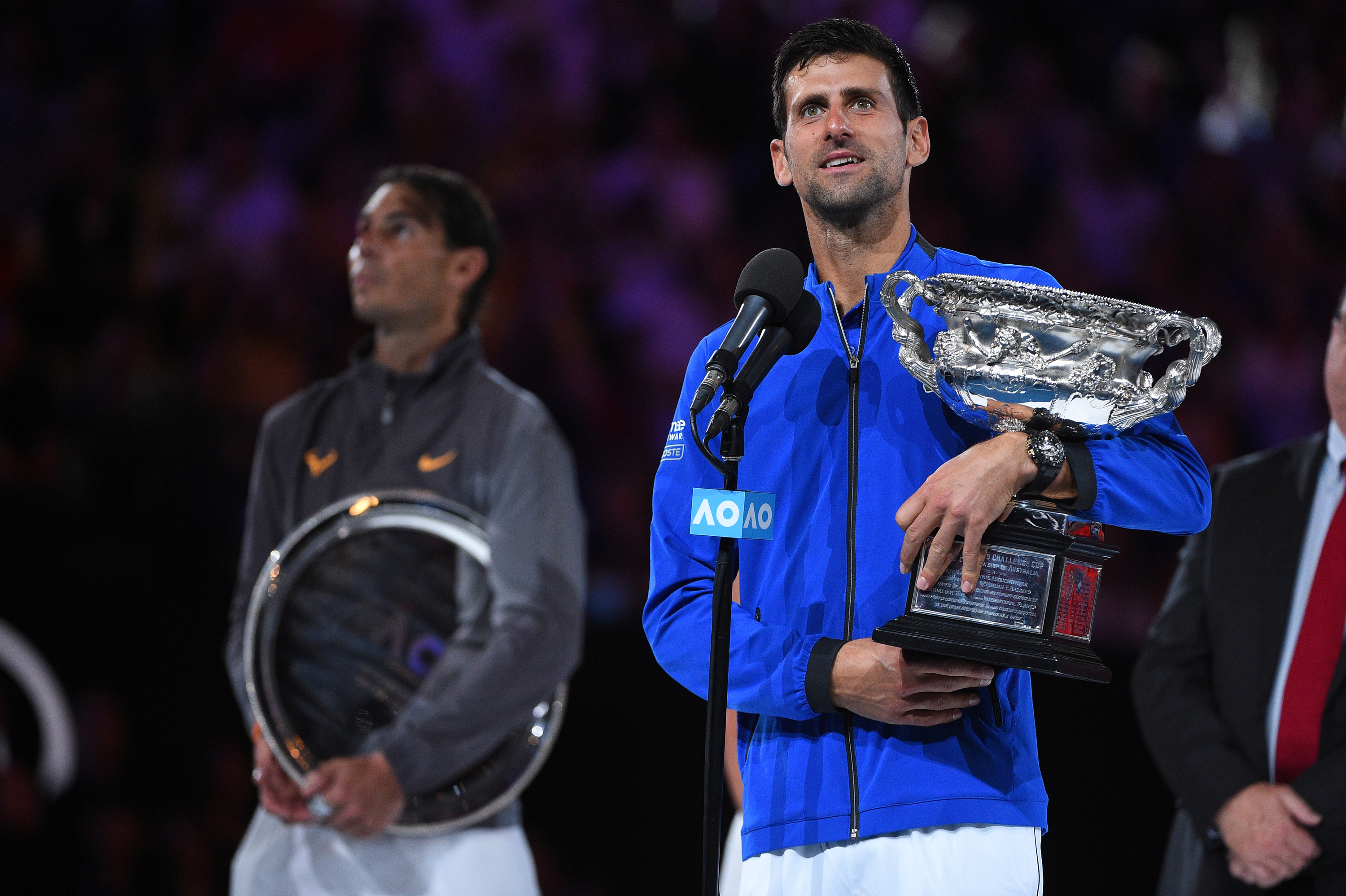 Novak Djokovic and Rafael Nadal on the podium during the trophy presentation at the 2019 Australian Open