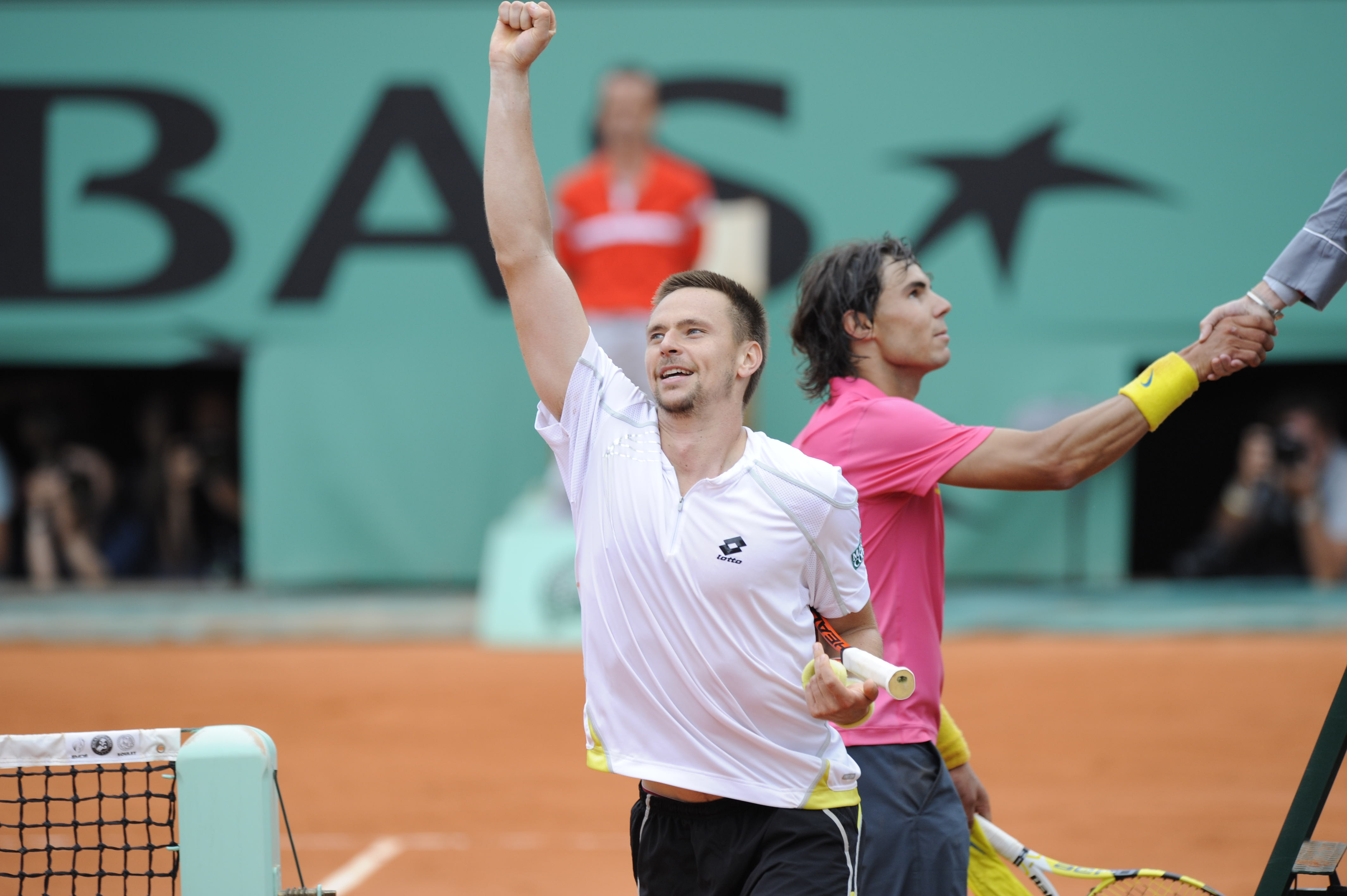 Robin Soderling celebrates his defeat of Rafael Nadal in the fourth round at Roland-Garros in 2009.