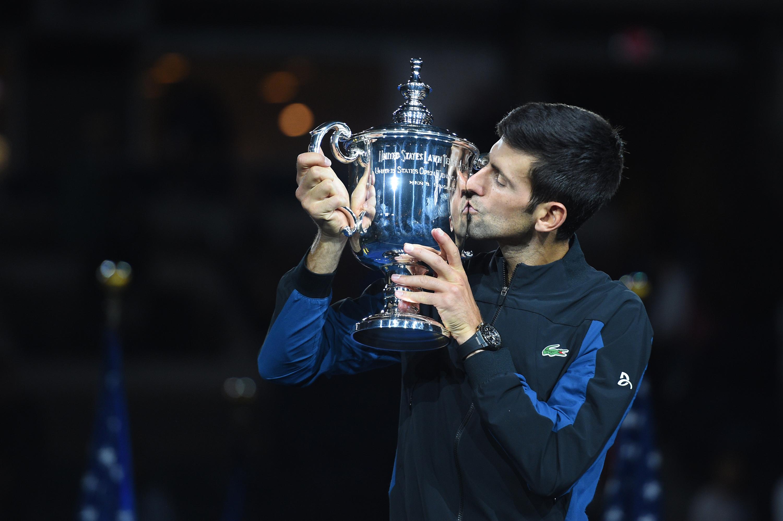 Novak Djokovic kisses the 2018 US Open trophy