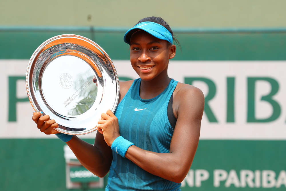 Cori Gauff with her girl's champion trophy at Roland-Garros 2018