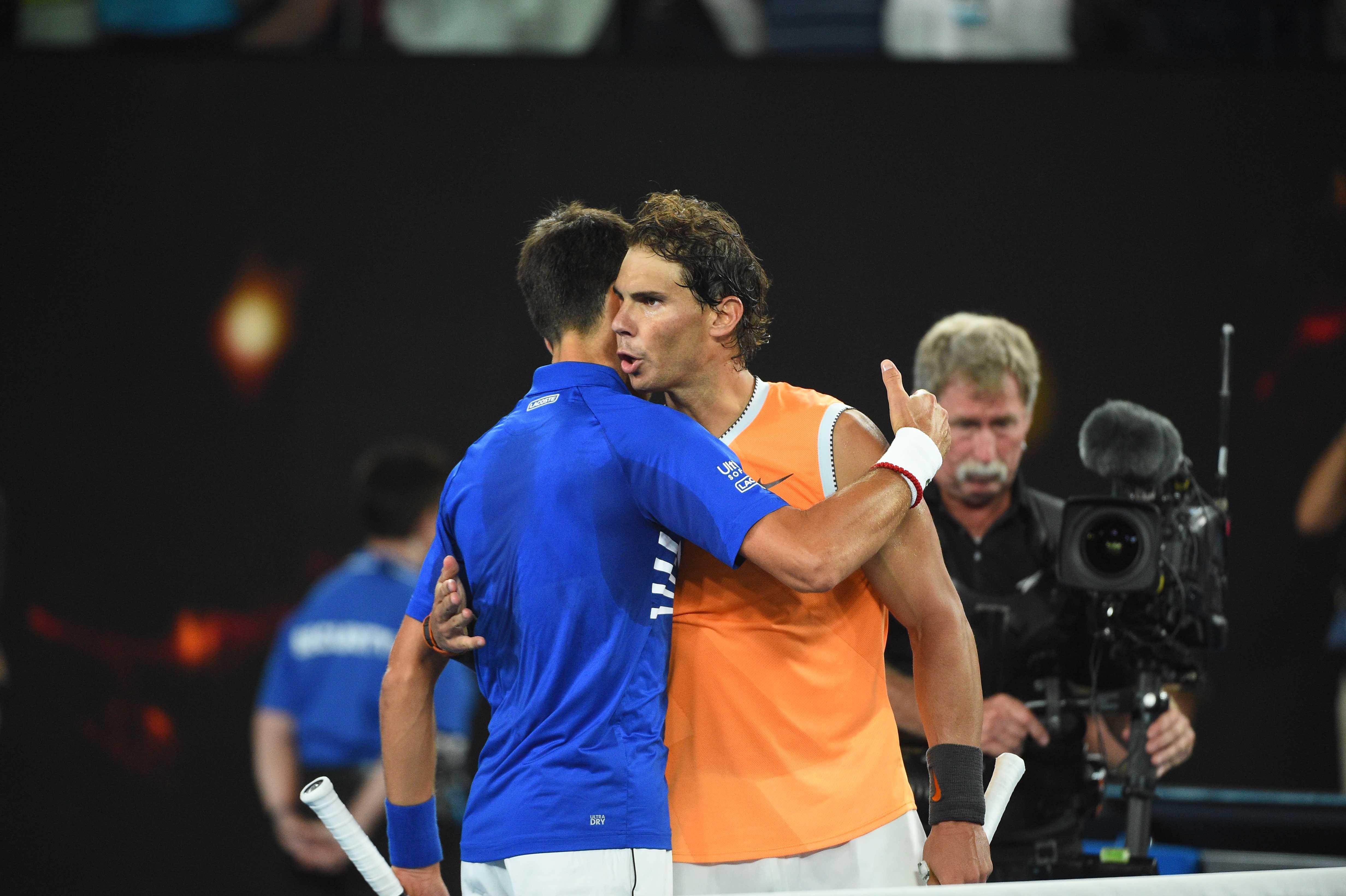 Rafael Nadal congratulates Novak Djokovic at the net during 2019 Australian Open final