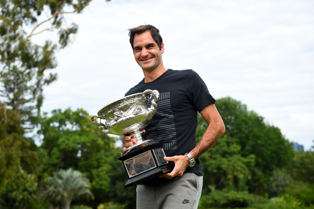 Roger Federer laughing with his Australian Open 2018 trophy the day after