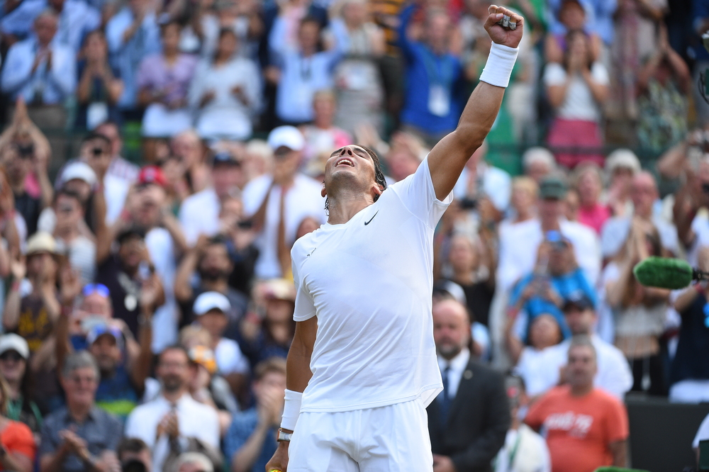 A victory gesture from Rafael Nadal at Wimbledon 2019