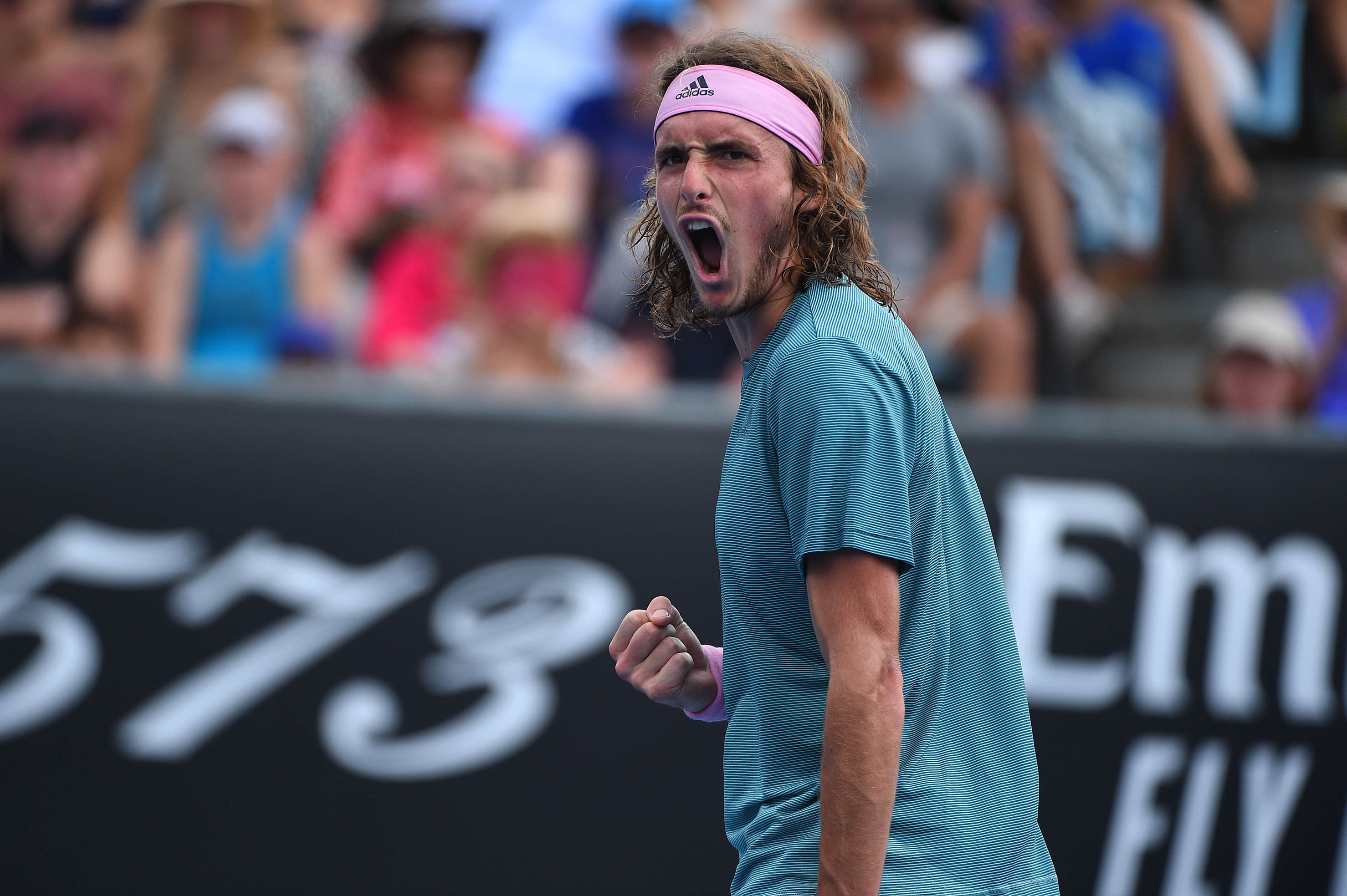 Stefanos Tsitsipas roaring during his second round match at the Australian Open 2019