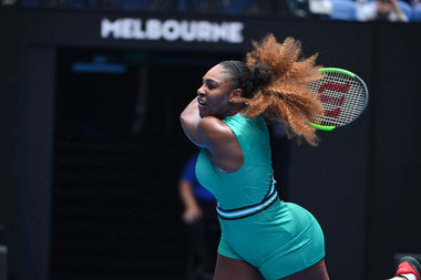 Serena Williams hitting a backhand during her first round match at the Australian Open 2019