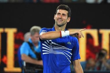 Novak Djokovic smiling after winning his semifinal at the 2019 Australian Open