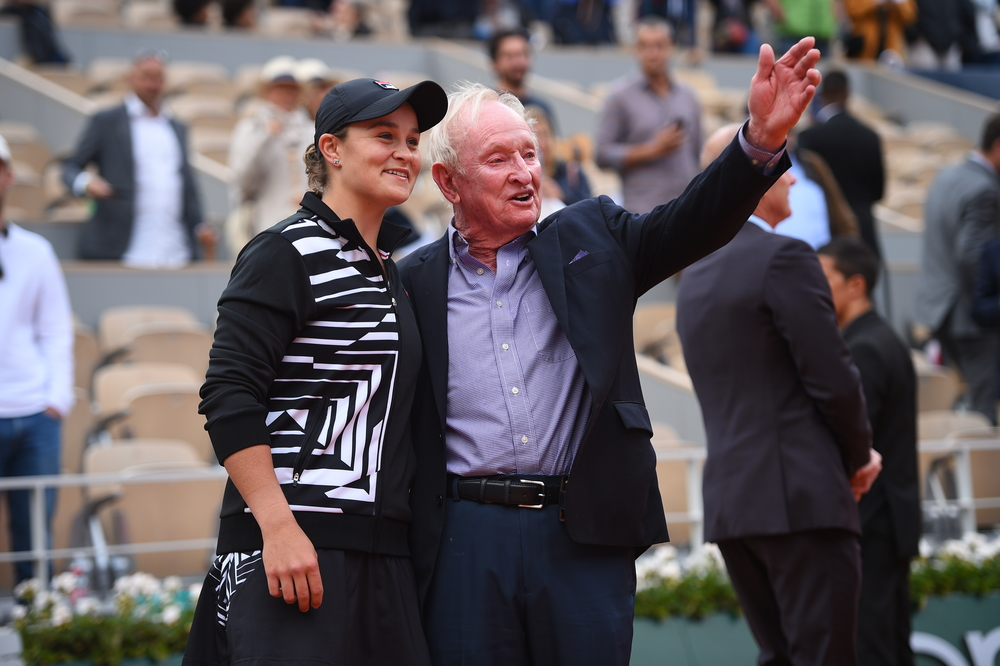 Ashleigh Barty smiling and chatting with Rod Laver at Roland-Garros 2019