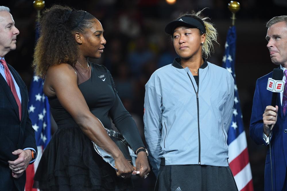 Serena Williams and Naomi Osaka both looking sad during the trophy presentation at the 2018 US Open.