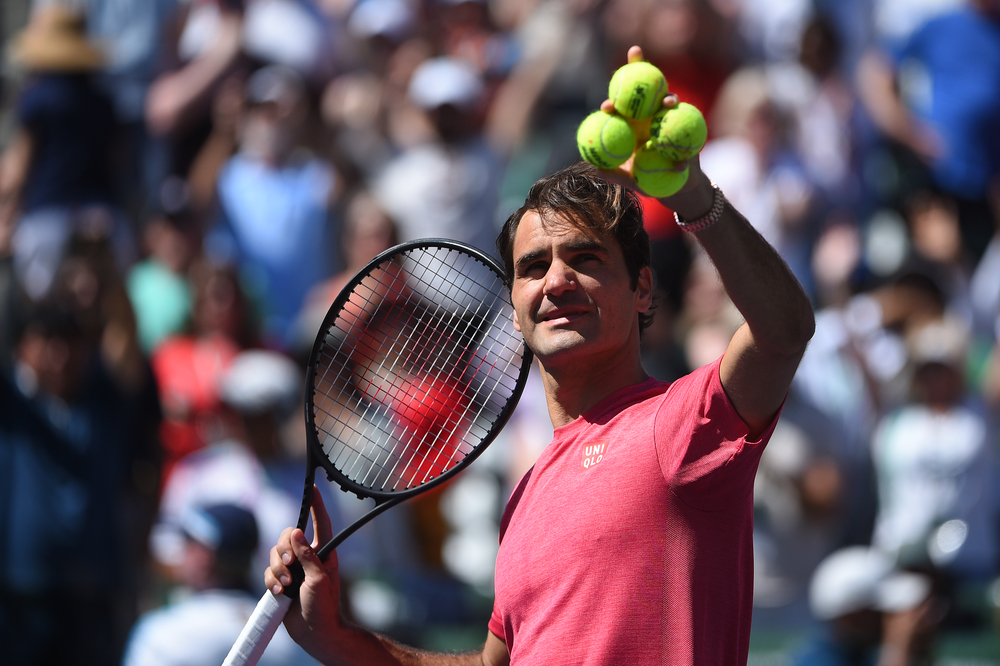 A relax Roger Federer is waiting to send some balls in the crowd at Indian Wells 2019