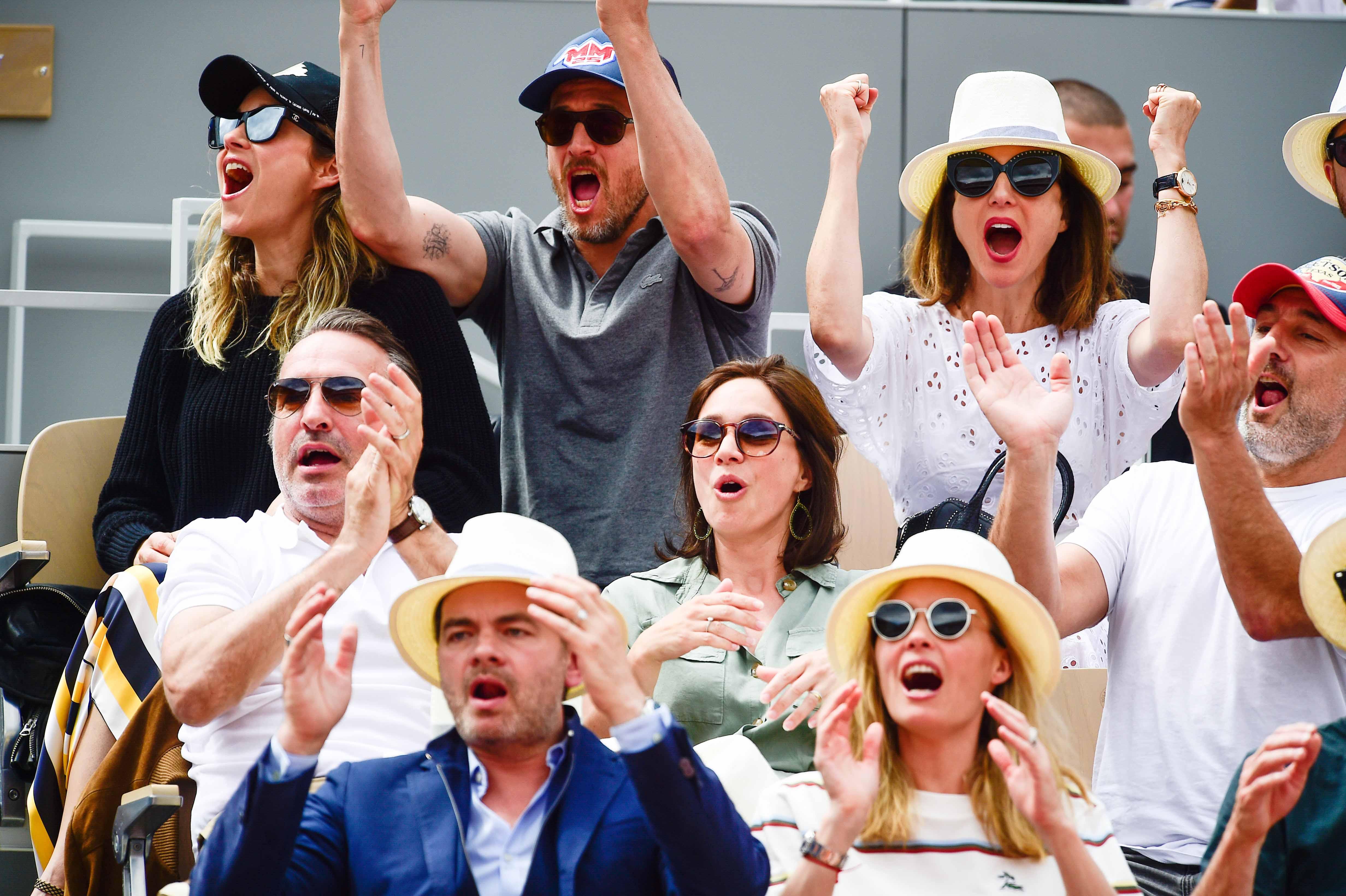 French actors Marion Cotillard, Guillaume Canet, Elsa Zylberstein, Jean Dujardin, Gilles Lellouche, Clovis Cornillac. And ice skater Nathalie Péchalat at Roland-Garros 2019