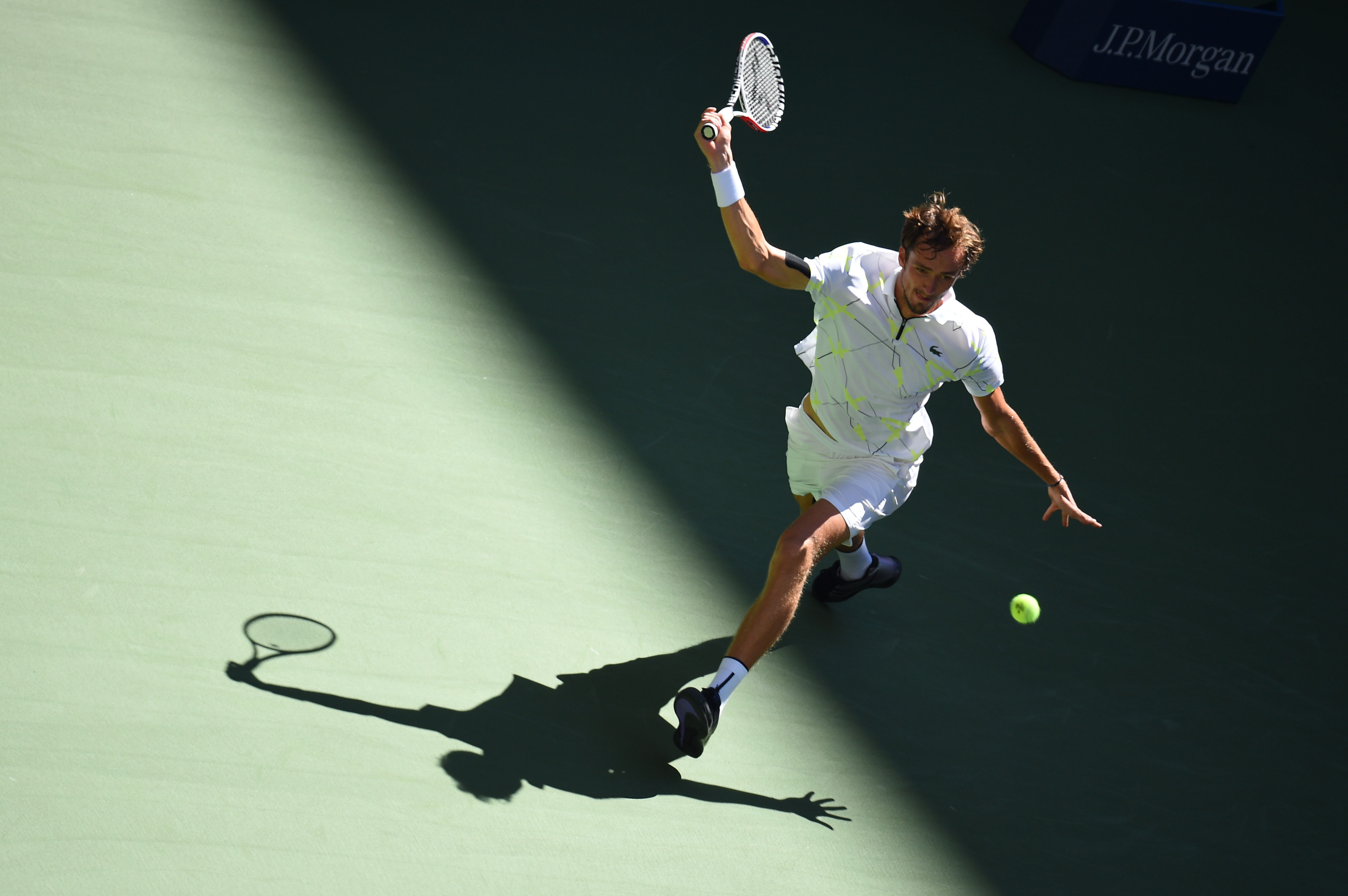 Daniil Medvedev in the light ans shadow at the 2019 US Open