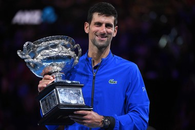 Novak Djokovic poses with his 2019 Australian Ope,n trophy