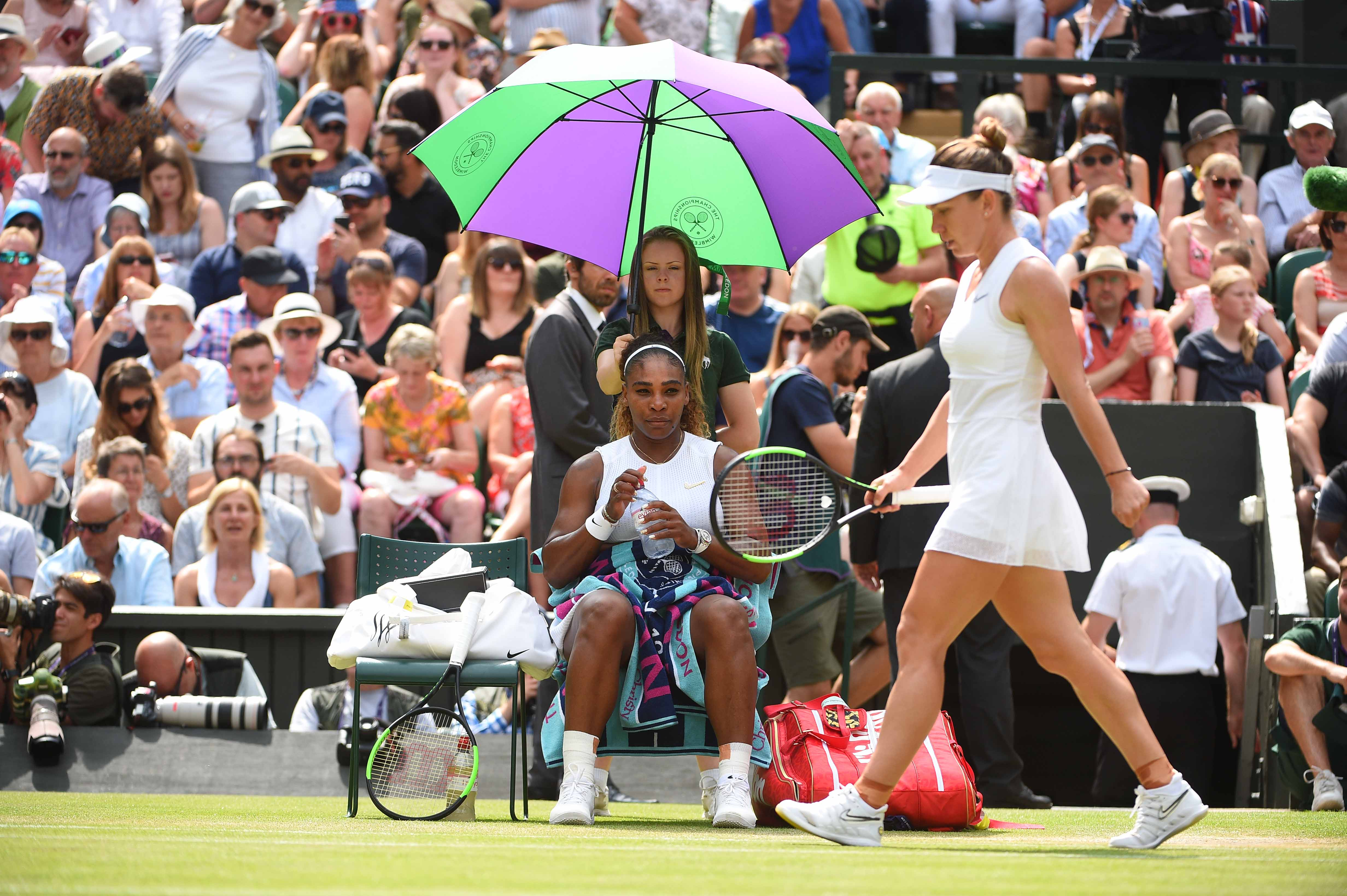 Serena Williams and Simona Halep during a changeover at Wimbledon 2019