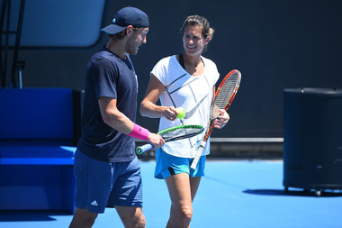 Amelie Mauresmo and Lucas Pouille talking during practice at the 2019 Australian Open
