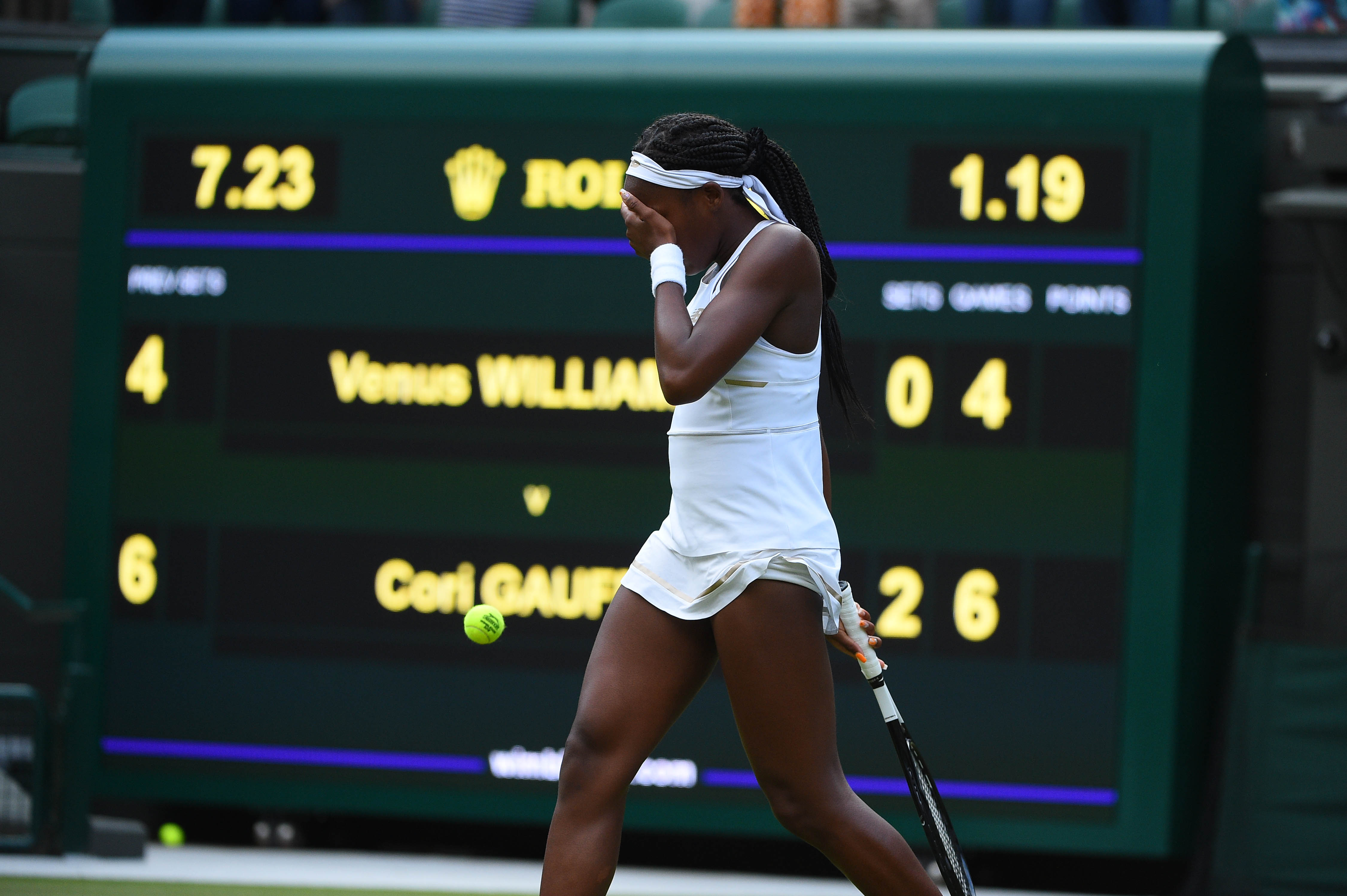 Cori Gauff crying in front of the score board after defeating Venus Williams at Wimbledon 2019