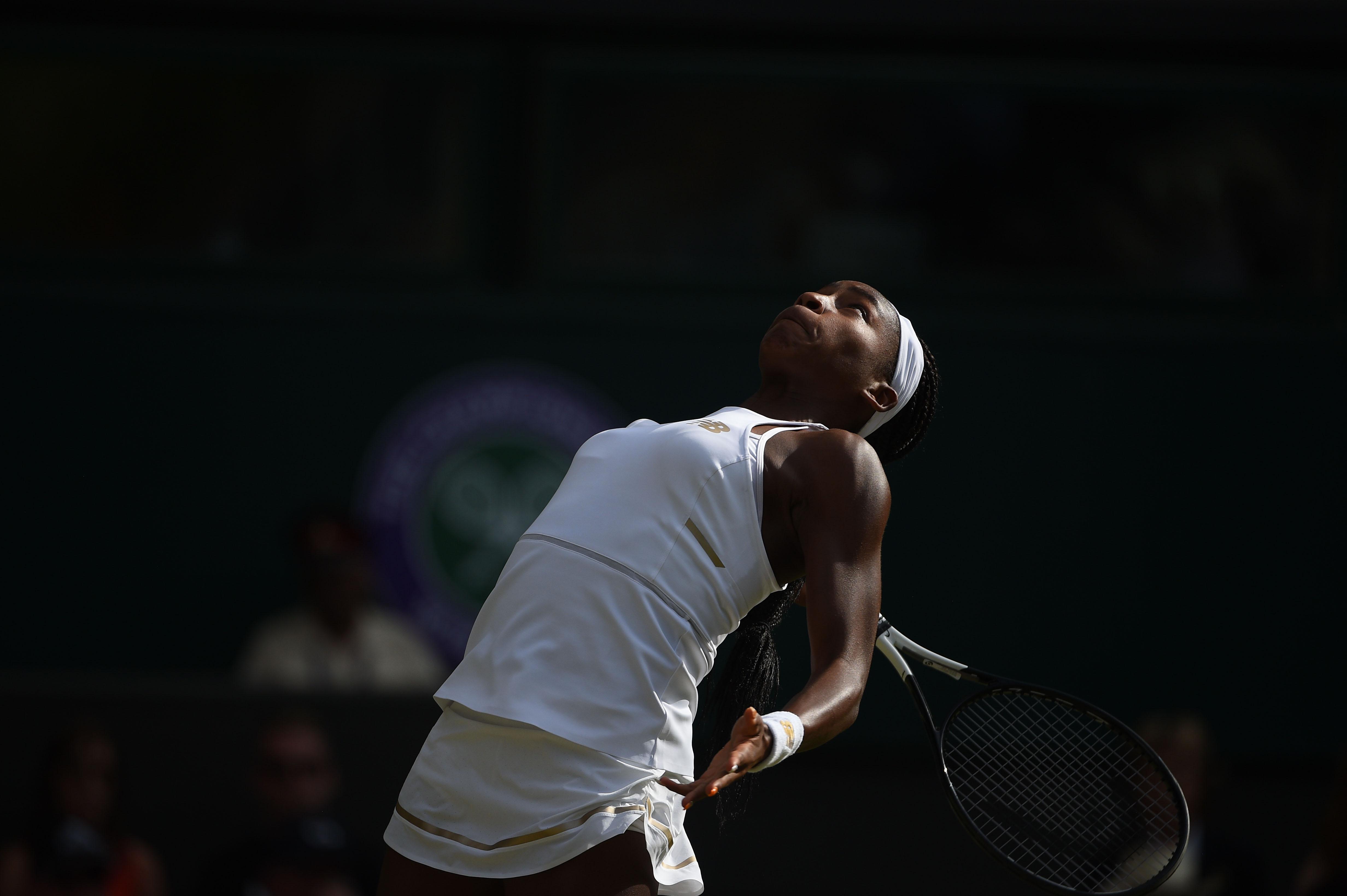 Cori Gauff serving in the beautiful light at Wimbledon 2019