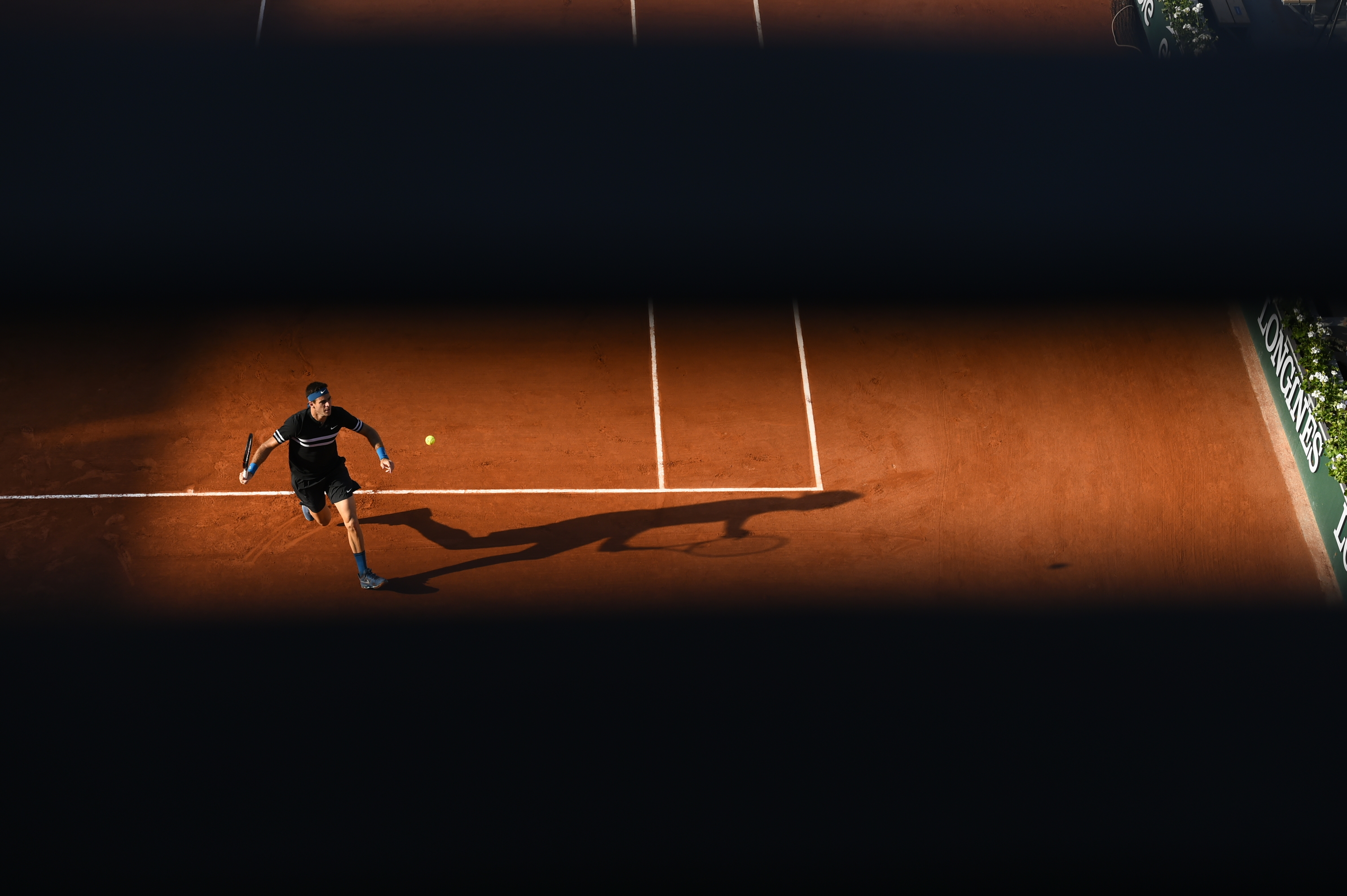 Juan Martin del Potro in light and shadow during Roland-Garros 2018