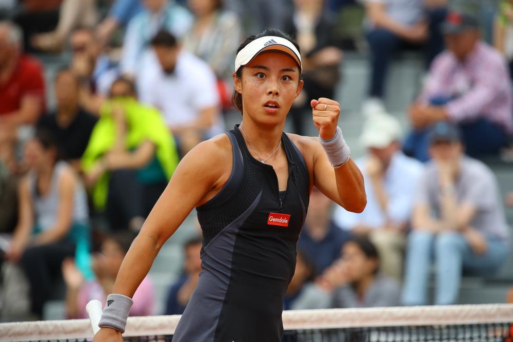 Qiang Wang fist pumping Roland-Garros 2018