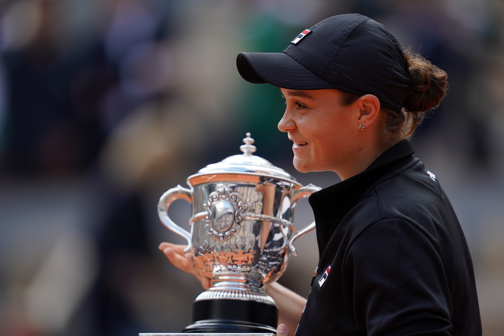 Ashleigh Barty's profile with her Roland-Garros trophy