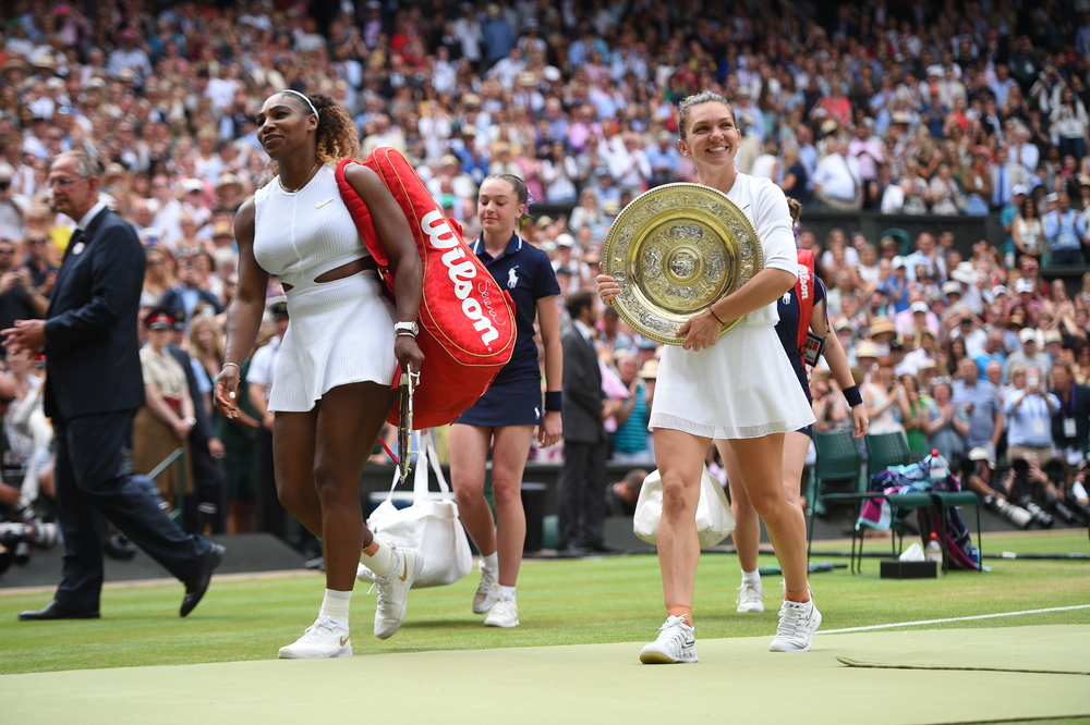 Serena Williams and Simona Halep smiling while exiting Centre Court at Wimbledon 2019