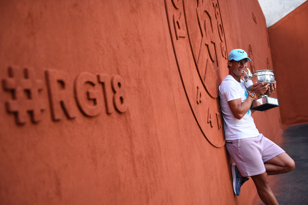 Rafael Nadal against the RG18 wall with his trophy Coupe des Mousquetaires Roland-Garros 2018