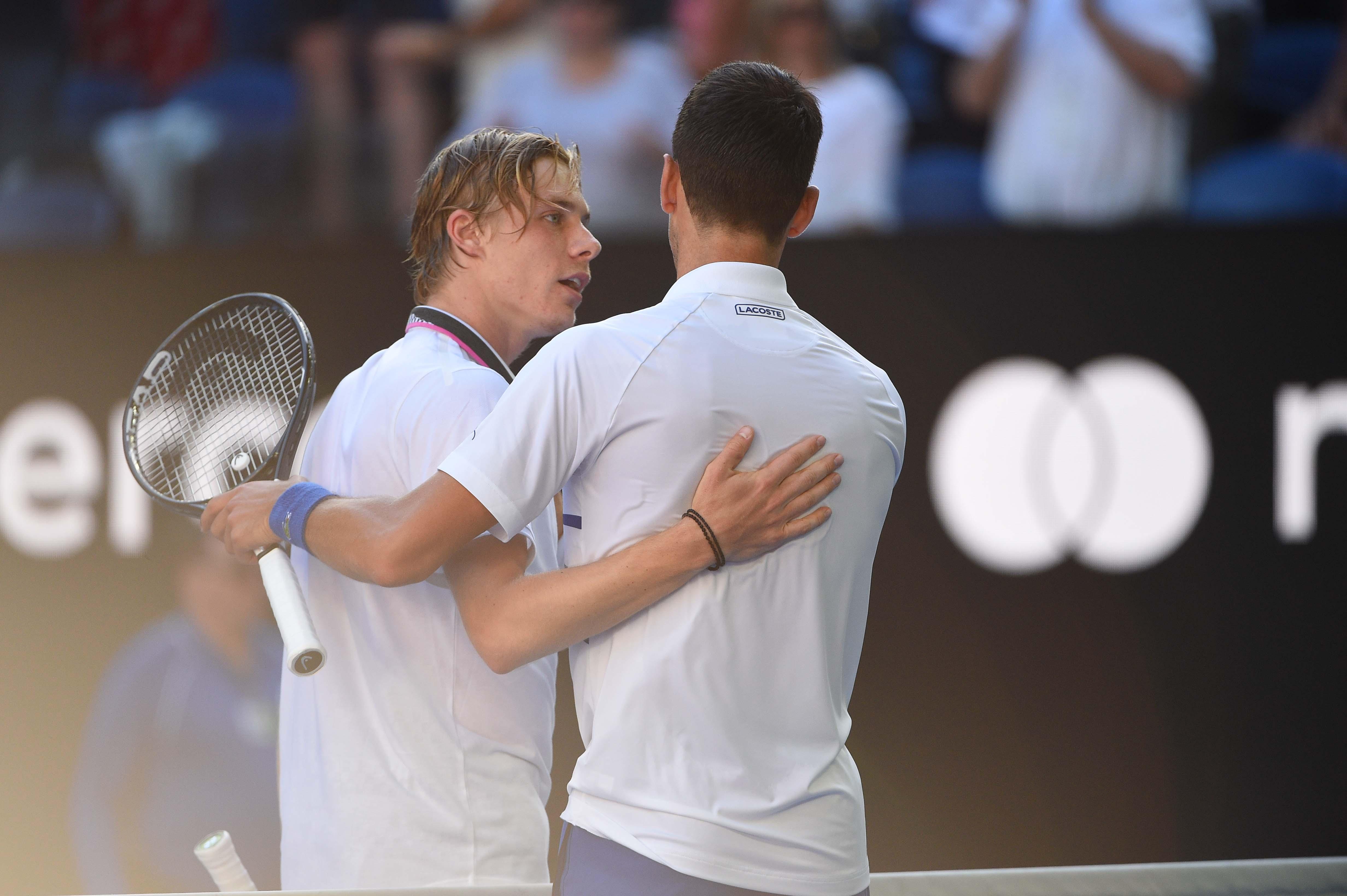 1c7e3ccbce6 Denis Shapovalov congratuling Novak Djokovic at the net during the Australian  Open 2019.