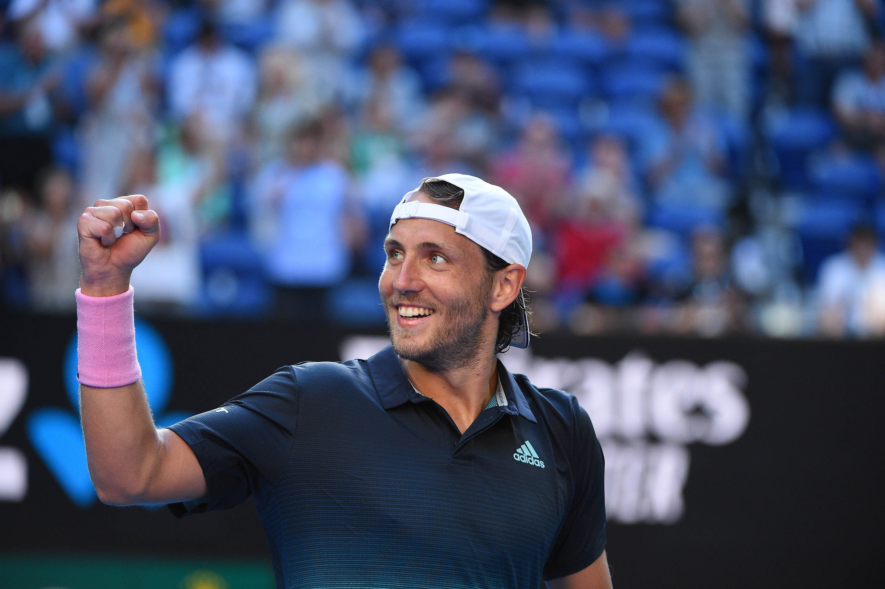 Lucas Pouille smiling and fistpumping after his victory in the quarters of the 2019 Australian Open